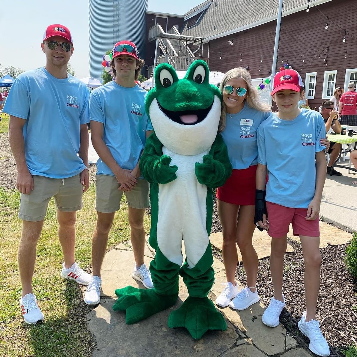 Group of people with the Bags of Fun Frog Mascot