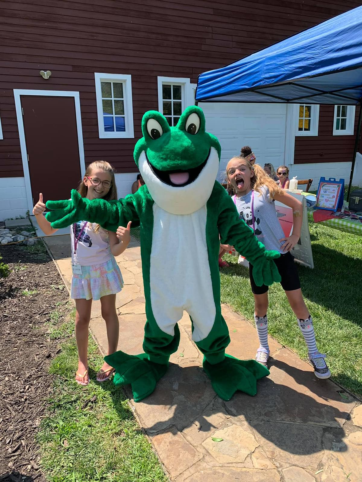 Kids with the Bags of Fun Frog Mascot