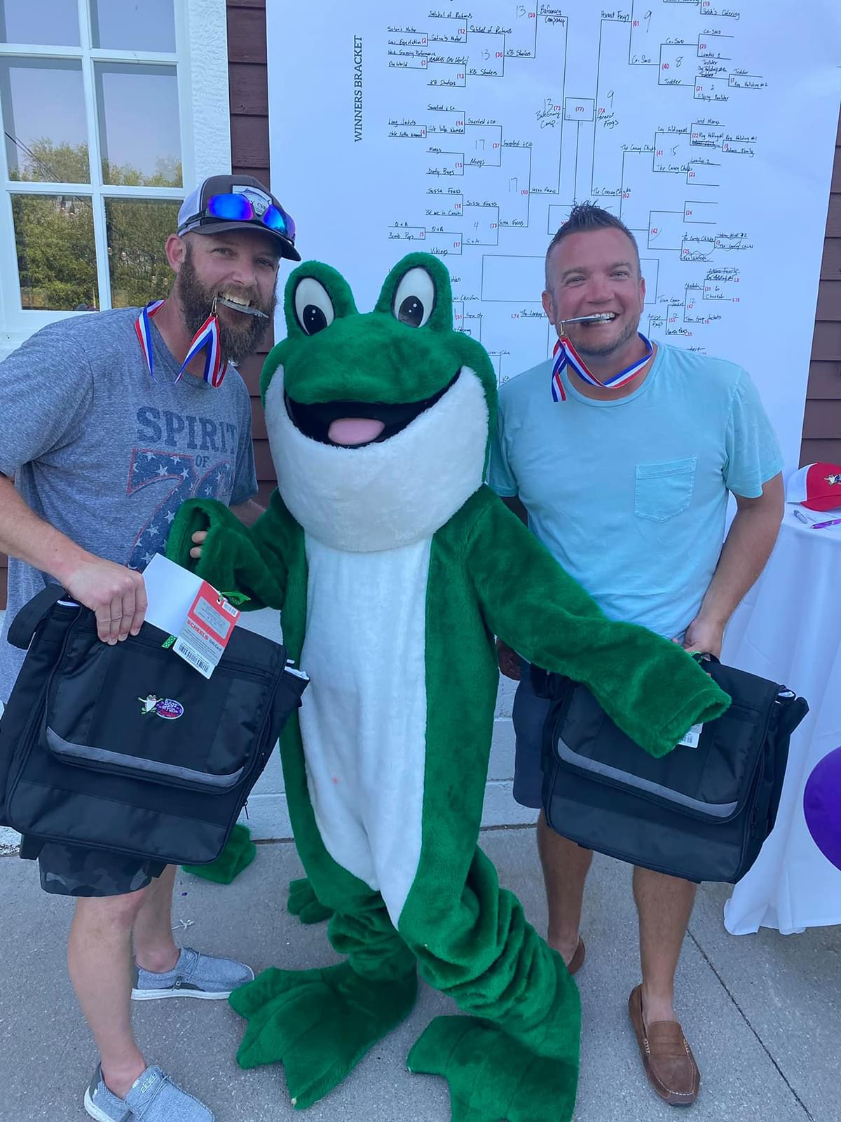 People with the Bags of Fun Frog Mascot