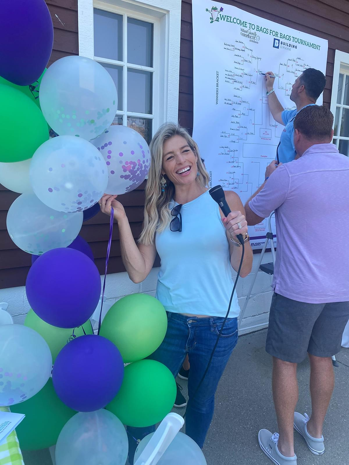 A woman taking a photo with balloons